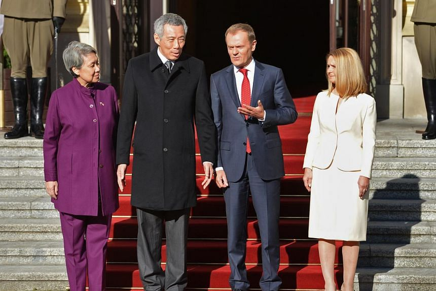 Prime Minister Lee Hsien Loong and Mrs Lee were greeted by Polish Prime Minister Donald Tusk and his wife, Mrs Malgorzata Tusk, at the Chancellery of the Prime Minister in Warsaw, on Oct 31, 2013.  PM Lee received a welcome at a ceremony at
