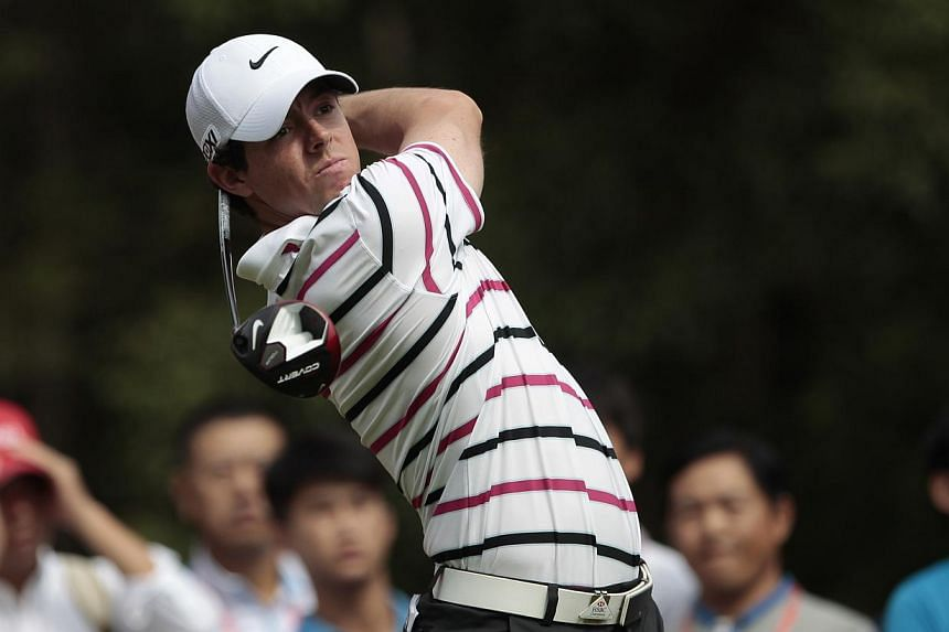 Rory McIlroy of Northern Ireland tees off on the 15th hole during the first round of the WGC-HSBC Champions golf tournament in Shanghai, Oct 31, 2013. McIlroy found himself leading a tournament for the first time since May, as he took control of the