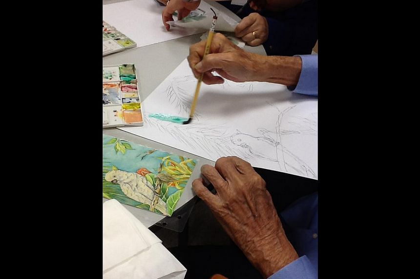 Patients painting during a MindVital session. The programme, which is suited for those with early signs of dementia, and whose sessions run for eight weeks, was spurred by feedback from families about  elderly patients being inactive at home.