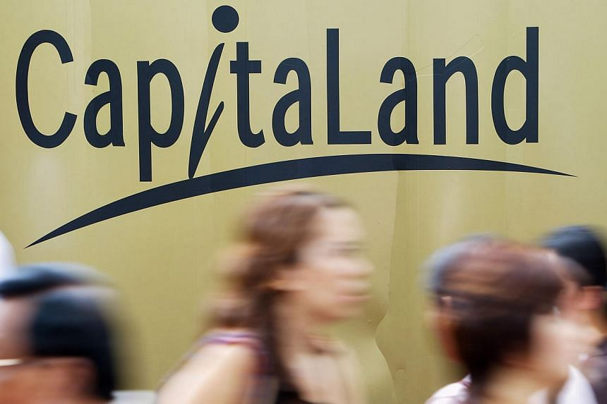Pedestrians walk past a billboard with CapitaLand Ltd.'s logo in Singapore, on Wednesday, Feb 14, 2007. Property giant CapitaLand said it will focus on developments that combine residential and commercial elements from now on, as the firm reported a