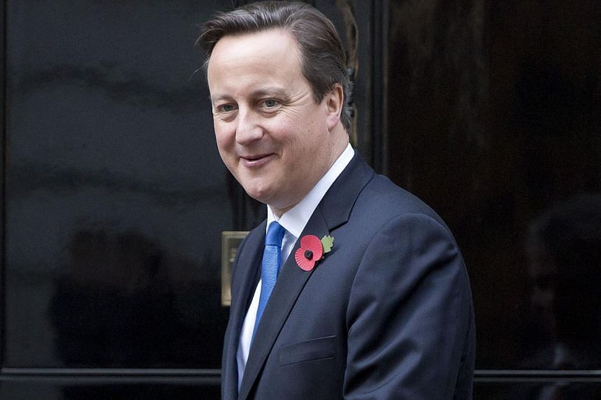 Britain's Prime Minister David Cameron waits to greet Jordan's King Abdullah at Number 10 Downing Street in London, on Oct 30, 2013. Mr Cameron is set to announce on Thursday that he will make public a new database of company ownership details design