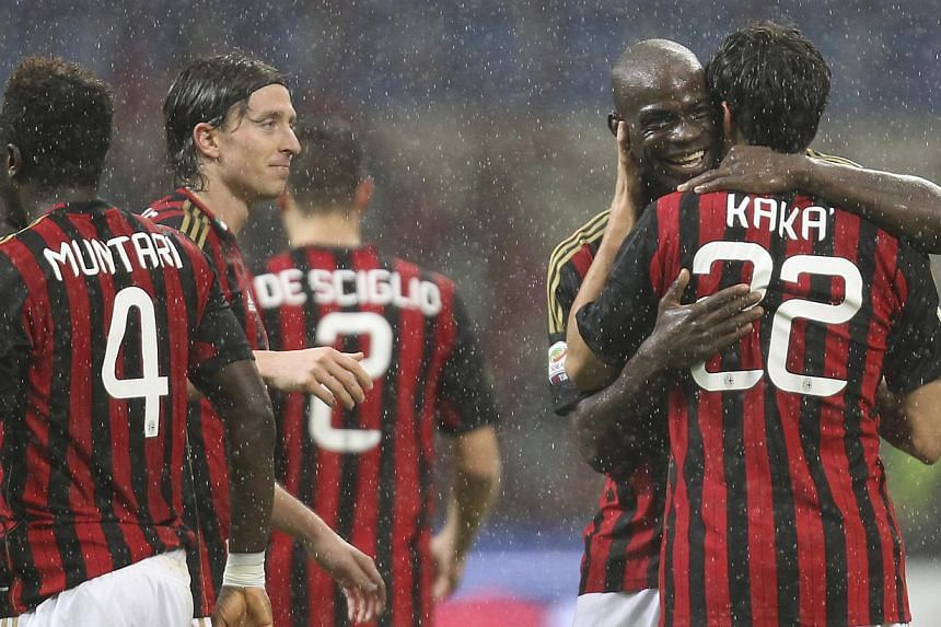 AC Milan' Kaka is embraced by forward Mario Balotelli after scoring during the Serie A soccer match between AC Milan and Lazio at the San Siro stadium in Milan, Italy, on Wednesday, Oct 30, 2013. -- PHOTO: AP