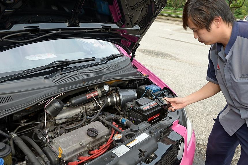 A STA inspector checking any modification of a car engine. -- ST PHOTO: DESMOND WEE