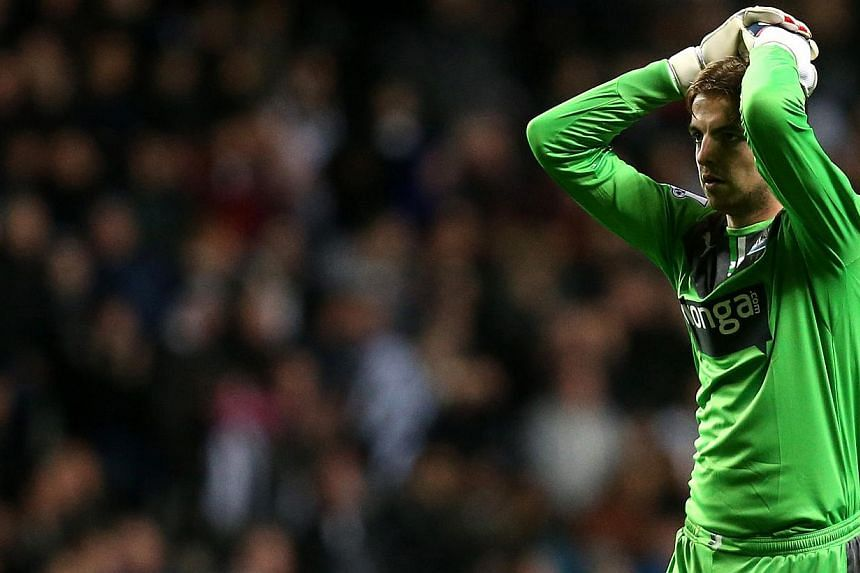 Newcastle United's goalkeeper Tim Krul stands dejected after his team were defeated by Manchester City at the end of their English League Cup soccer match at St James' Park, Newcastle, England, on Wednesday, Oct 30, 2013. Manchester City reached the