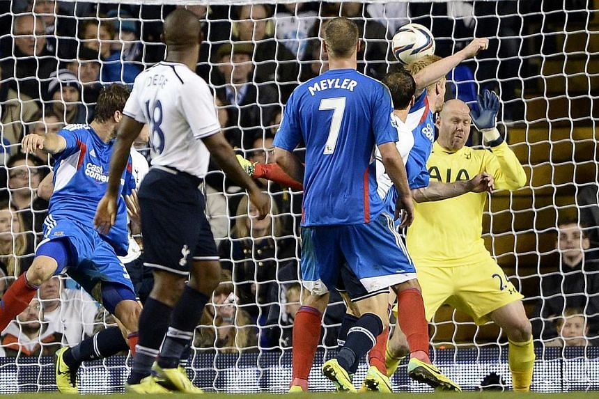 Hull City's Paul McShane (2nd right) scores past Tottenham Hotspur's Brad Friedel (right) during their English League Cup fourth round soccer match at White Hart Lane in London, on Oct 30, 2013. -- PHOTO: REUTERS