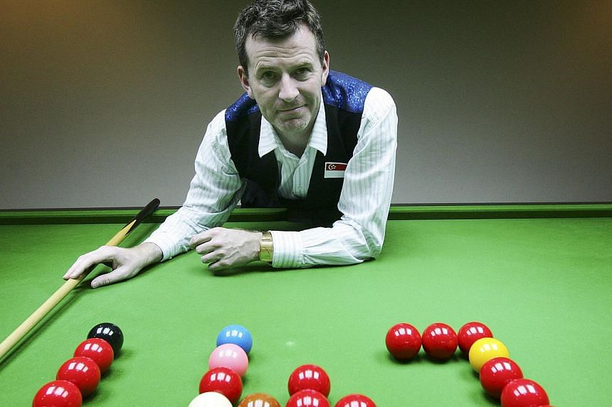 "Peter Gilchrist, an Asian champion and top world billiards player at the Cuesports centre with his custom-made ""Hunt & O'Byrne"" cue. Singaporean Peter Gilchrist has won the International Billiards and Snooker Federation (IBSF) World Billiards C"