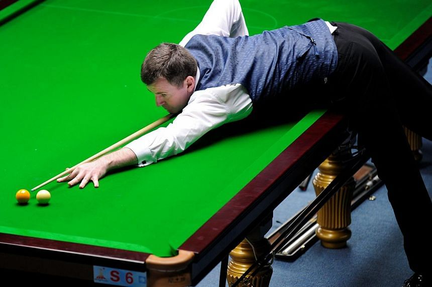 Singapore billiards player Peter Gilchrist in action during the Asian Games semi-final match against Myanmar's Oo Nay Thway Oo in Guangzhou, China, on Nov 14, 2010. -- ST FILE PHOTO: LIM SIN THAI