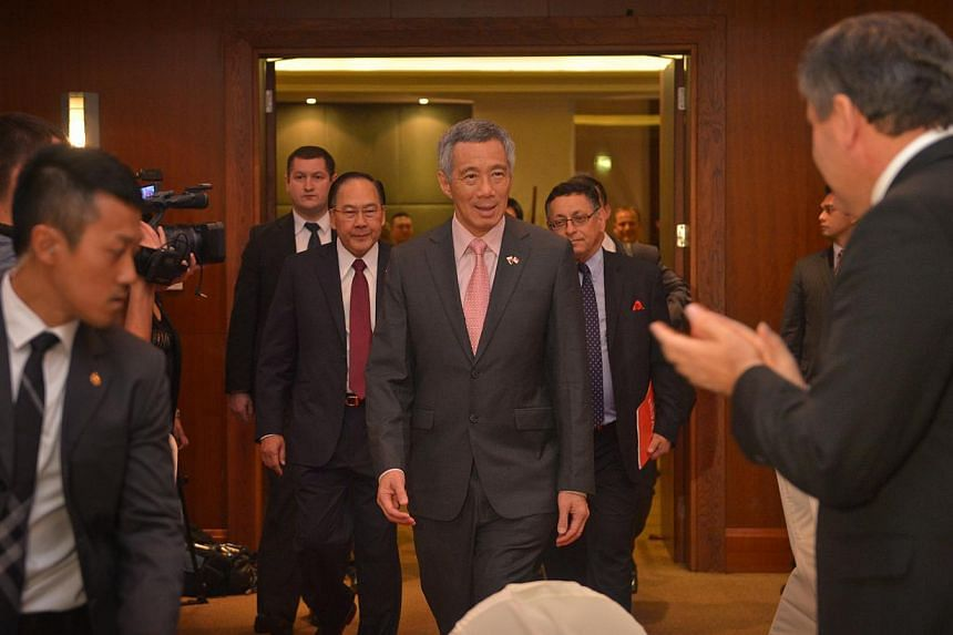 Prime Minister Lee Hsien Loong arrives at the Singapore-Poland Business Forum held at the Hyatt Hotel in Warsaw, Poland, on Oct 30, 2013. -- ST PHOTO: CAROLINE CHIA