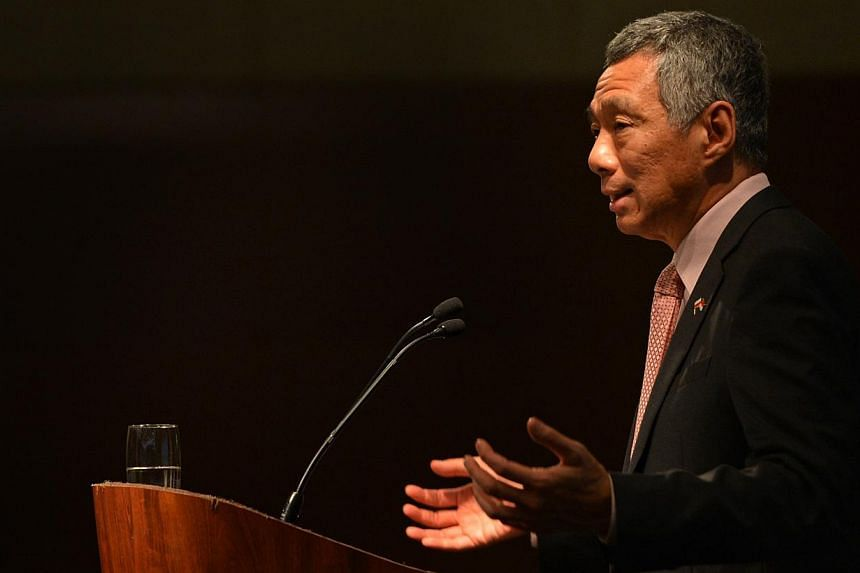 Prime Minister Lee Hsien Loong delivers a keynote address at the Singapore-Poland Business Forum held at the Hyatt Hotel in Warsaw, Poland, on Oct 30, 2013. -- ST PHOTO: CAROLINE CHIA