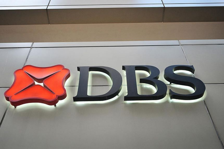 DBS logged a record net interest income in the third quarter to lift its net profit to $862 million, a one per cent increase over the same period a year ago. -- ST FILE PHOTO:ALPHONSUS CHERN