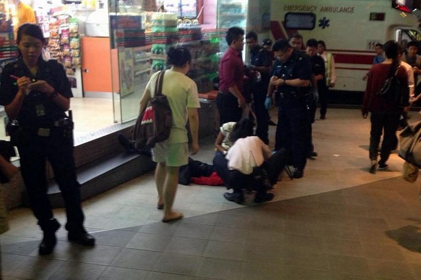 Police officers outside the 7-Eleven at Cathay Cineleisure Orchard, where a 23-year-old man was attacked by a group of men on Dec 27, 2012. A cleaner who launched a vicious and unprovoked attack on two men outside Cathay Cineleisure Orchard last Dece