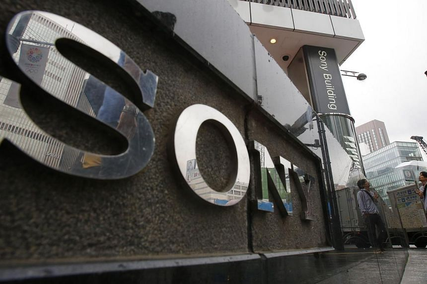 Shares in Sony plunged more than 11 percent on Friday morning after the Japanese electronics giant slashed its full-year profit outlook, dealing a blow for its much-vaunted turnaround plan. -- FILE PHOTO: AP