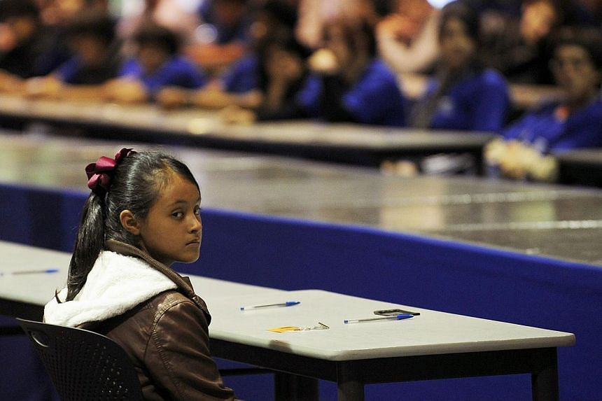 Twelve years old Paloma Noyola listens to instructions during a two-day National Mental Math Calculation Championships at the Technologic of Monterrey campus, in Mexico City, on Oct 28, 2013. Mexico has found a new heroine: A 12-year-old math whiz fr