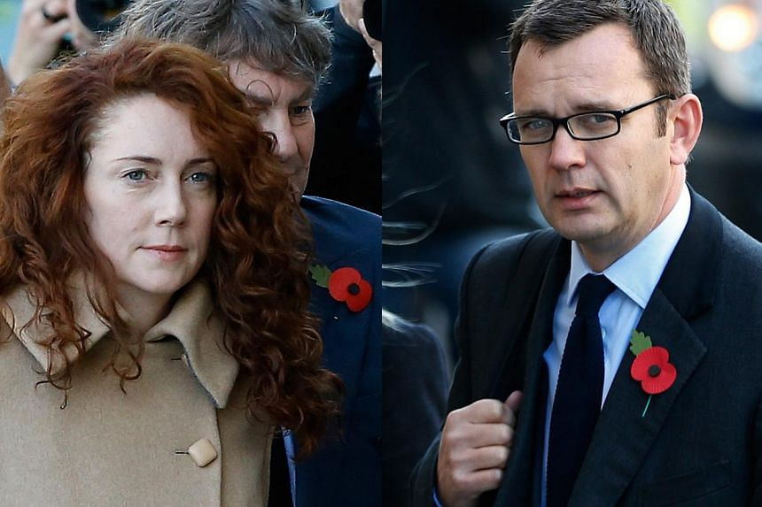 This combination of Monday, Oct. 28, 2013 file photos shows former News of the World editor Rebekah Brooks and husband Charlie Brooks, left image, and former News of the World editor Andy Coulson as they arrive at The Old Bailey law court in London.&