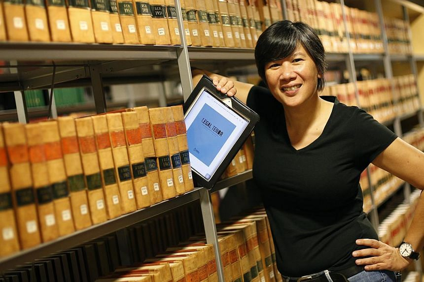 Curator of Legal Tenor: Voices from Singapore's Legal History (1930-1959), Eleanor Wong, poses for a photograph in the Supreme Court library on Oct 31, 2013. The 274-page work features transcripts of interviews with 15 legal personalities, including