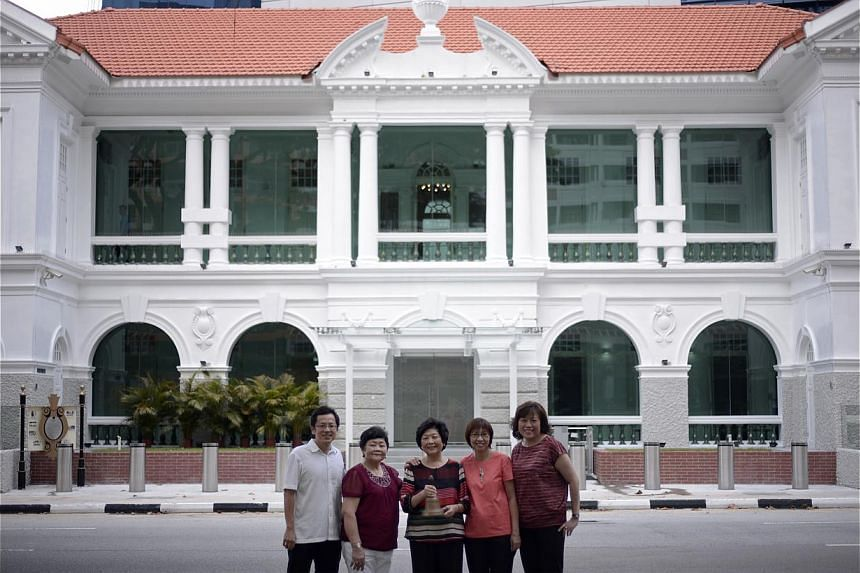 Standing in front of the restored building in Neil Road are (from left) Mr Patrick Tan, 45, who grew up on the grounds of the old school; his mother Ong Thian Wah, 72, a long-time staff attendant at the school; former Fairfield principal Tang Poh Kim