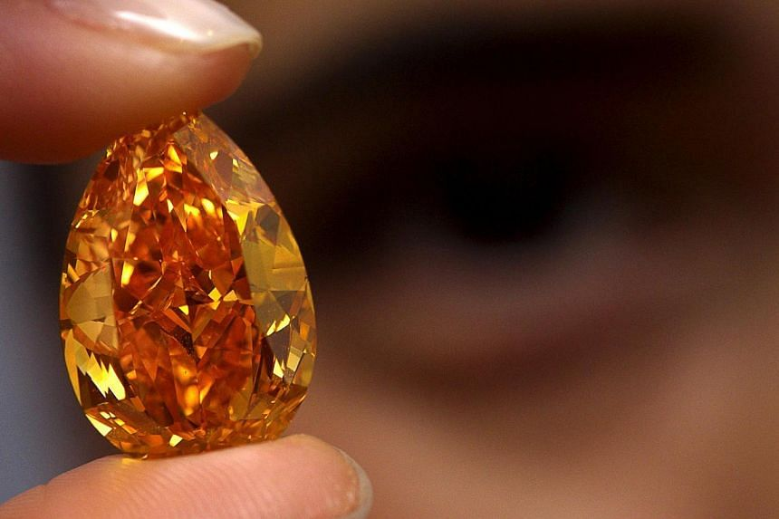 The Orange, thelargest fancy vivid orangediamond to come to auction, will go on sale next week in Switzerland, with the rare gem expected to fetch a record US$17-20 million (up to S$24.8 million), auctioneers said on Friday. -- PHOTO: REU