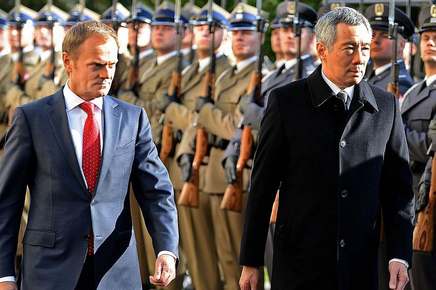 Singapore's Prime Minister Lee Hsien Loong (right), accompanied by Polish Prime Minister Donald Tusk (left), receives military honours at the beginning of their meeting in Warsaw on Oct 31, 2013. Singapore is relevant in the world because it is succe