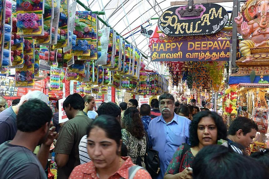 The crowds were out in force at the Deepavali festival village bazaar in Hastings Road and Campbell Lane in Little India on Nov 1, 2013, cramming in some last-minute shopping in preparation for the festival, which falls on Nov 2, 2013. -- ST PHOTO: N