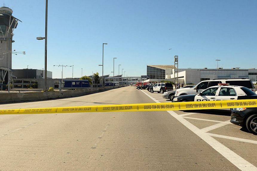 Police tape blocks off the road leading up to Los Angeles International Airport (LAX) after a shooting inside Terminal 3 at LAX, Nov 1, 2013 in Los Angeles, California. -- PHOTO: