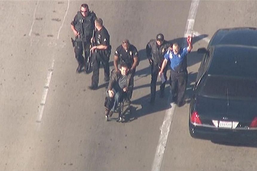 Police escort a man in a wheelchair toward medical help during an incident in which shots were fired at Los Angeles International Airport in Los Angeles in this still image taken from video provided by KNBC, Nov 1, 2013. -- PHOTO: REUTERS