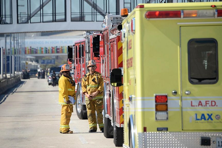 Firetrucks are positioned outside Terminal 3 at Los Angeles International Airport on Nov 1, 2013 after a gunman reportedly opened fire at a security checkpoint. -- PHOTO: AFP