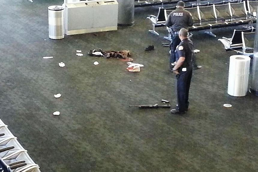 In this photo provided to the AP, which has been authenticated based on its contents and other AP reporting, police officers stand near an unidentified weapon in Terminal 3 of the Los Angeles International Airport on Friday, Nov 1, 2013.United States