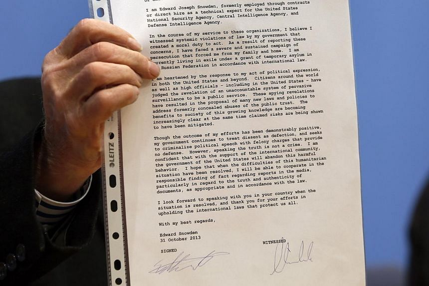 A letter from Edward Snowden to the media is shown prior to a press conference in Berlin, Germany, on Friday, Nov 1, 2013.Spy agencies across Western Europe are working together on mass surveillance of Internet and phone traffic comparable to p