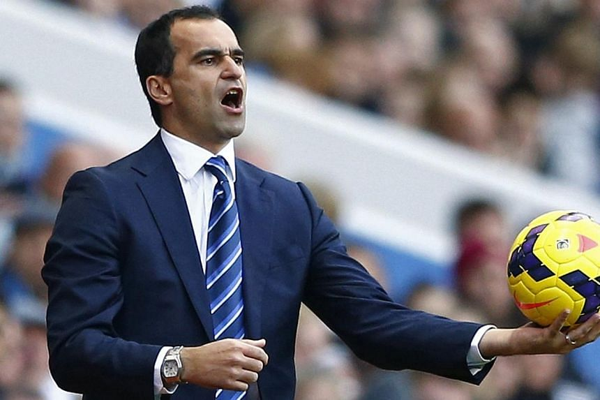 Everton's manager Roberto Martinez instructs his team during their English Premier League match against Aston Villa on Oct 26, 2013.Everton can send out a message that there is more than one team on Merseyside capable of challenging at the top