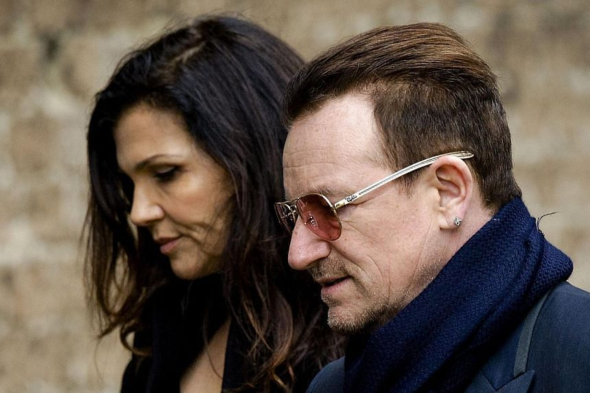 Singer Bono of U2 and his wife Ali Hewson arrive at the Old Church in Delft for the memorial of late Dutch Prince Friso on Nov 2, 2013. -- PHOTO: AFP