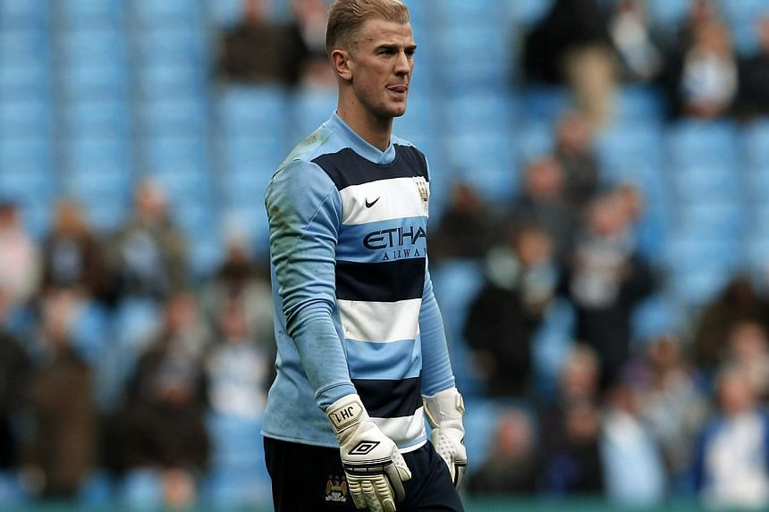 Manchester City's goalkeeper Joe Hart looks on during the warm-up session ahead of their English Premier League soccer match against Norwich City at the Etihad Stadium in Manchester, northern England on Nov 2, 2013. -- PHOTO: REUTERS&nbsp