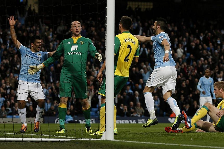 Manchester City's Alvaro Negredo (second, right) celebrates after scoring his side's fourth goal during their English Premier League soccer match against Norwich City at the Etihad Stadium in Manchester, northern England on Nov 2, 2013. -- PHOT