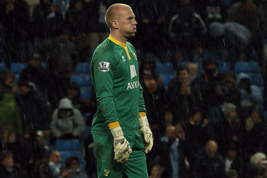 Norwich City's John Ruddy reacts after his side where beaten 7-0 by Manchester City in their English Premier League soccer match at the Etihad Stadium in Manchester, northern England on Nov 2, 2013. -- PHOTO: REUTERS