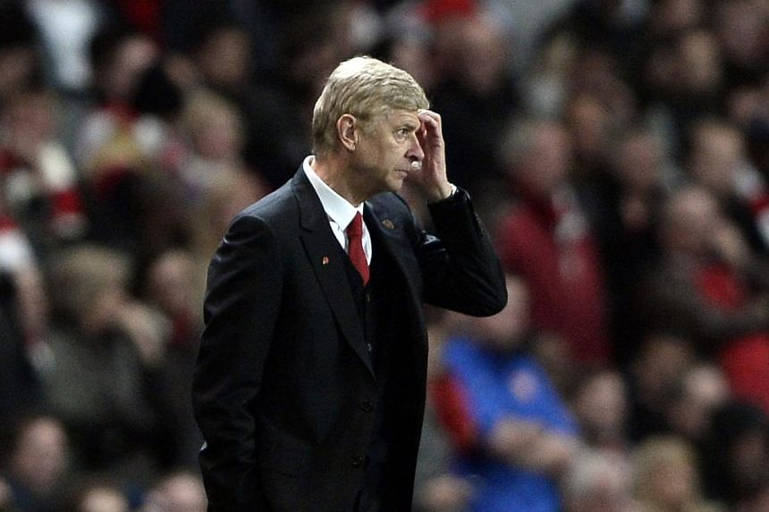 Arsenal manager Arsene Wenger reacts during their English Premier League soccer match against Liverpool at the Emirates stadium in London on Nov 2, 2013. -- PHOTO: REUTERS