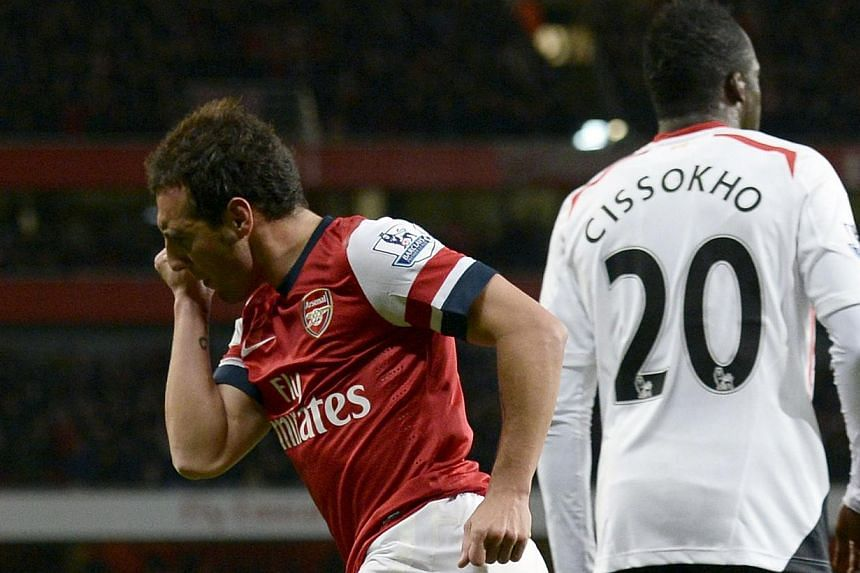 Arsenal's Santi Cazorla (left) celebrates after scoring a goal against Liverpool during their English Premier League soccer match at the Emirates stadium in London Nov 2, 2013. -- PHOTO: REUTERS