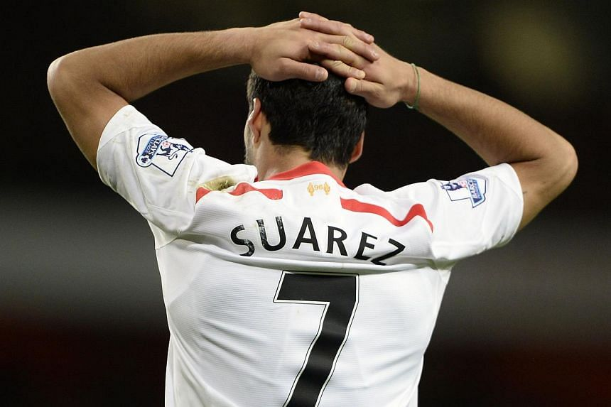 Liverpool's Luis Suarez reacts after a missed opportunity during their English Premier League soccer match against Arsenal at the Emirates stadium in London on Nov 2, 2013. -- PHOTO: REUTERS