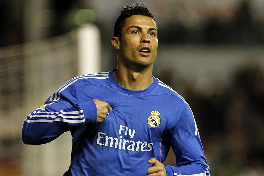 Real Madrid's Cristiano Ronaldo, from Portugal, celebrates after scoring the opening goal during Spanish La Liga soccer match between Real Madrid and Rayo Vallecano at the Vallecas stadium in Madrid, on Saturday, Nov 2, 2013.Ronaldo had scored