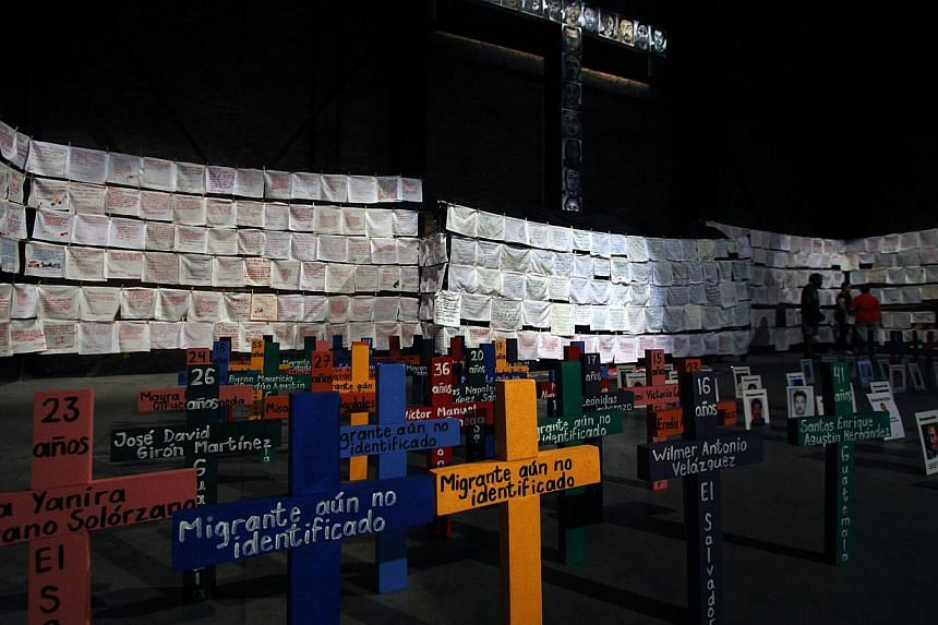 "View of a memorial installed by the ""Embroidering for Peace"" civil movement with handkerchiefs embroidered with the names of victims of violence in Guadalajara, Mexico, on Nov 2, 2013, on Day of the Dead. -- PHOTO: AFP"
