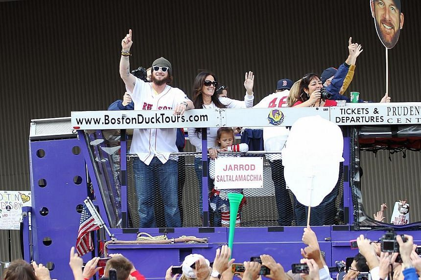 Jared Saltalamacchia reacts to the crowd from one of the duck boats as they make their way down Tremont Street where fans gathered for the World Series victory parade for the Boston Red Sox on Nov 2, 2013 in Boston, Massachusetts. -- PHOTO : AFP