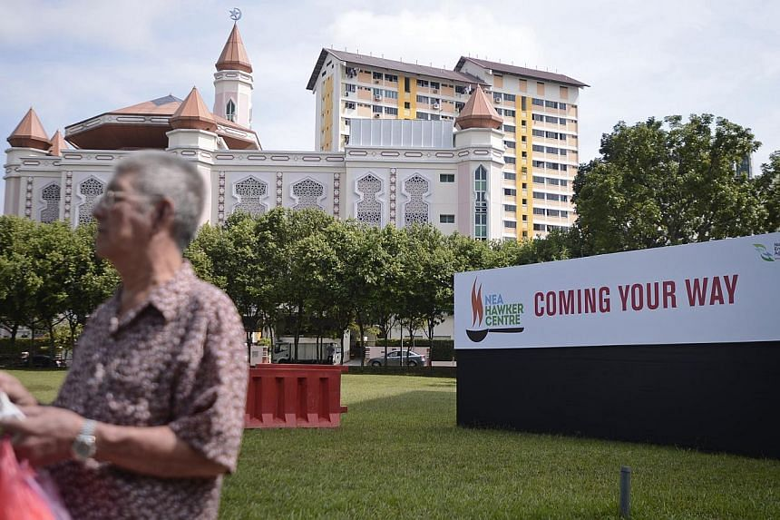 An elderly man passes by the area where the new Bukit Panjang Hawker Centre will be built on Nov 3, 2013. The hawker centre will be the first standalone centre to be completed in 2015. -- ST PHOTO : MARK CHEONG