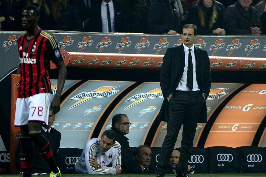 "AC Milan's coach Massimiliano Allegri (right) looks on during the Italian serie A football match AC Milan vs Fiorentina, on Nov 2, 2013, in San Siro stadium in Milan. Allegri has demanded improvements after what he labelled an ""embarrassing"" la"