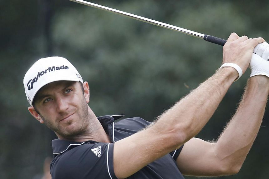 Dustin Johnson of the United States tees off the 6th hole during the final round of the HSBC Champions golf tournament at the Sheshan International Golf Club in Shanghai, China, Sunday, Nov 3, 2013. Johnson pitched in for eagle at the 16th hole to se