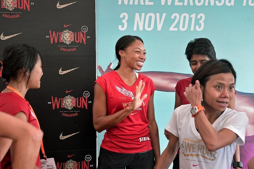 Olympic and world champion Allyson Felix meeting the top 30 finishers for a mingling and photo-taking session at the Nike We Run Singapore race held at the F1 Pit Building on Nov 3, 2013. -- ST PHOTO: KUA CHEE SIONG