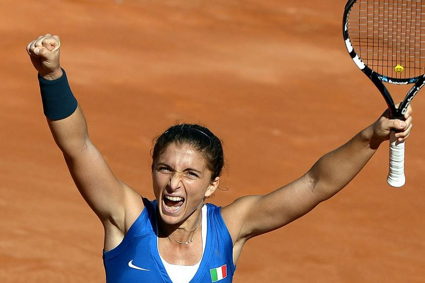 Italy's Sara Errani celebrates after defeating Russia's Alisa Kleybanova during their International Tennis Federation Fed Cup final match between Italy and Russia in Cagliari, on Nov 3, 2013. Sara Errani romped to a 6-1, 6-1 win over Alisa Kleybanova