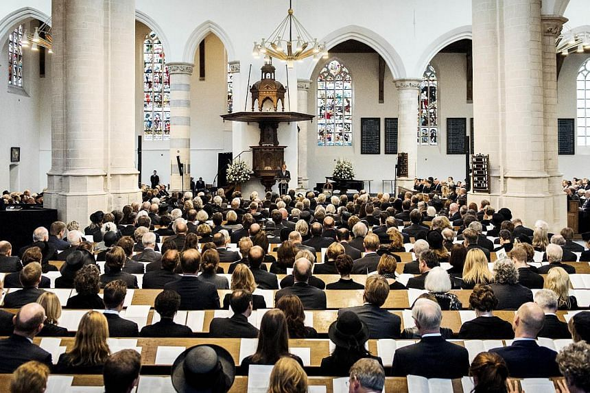 Dutch King Willem-Alexander delivers a speech during the memorial of late Dutch Prince Friso on Nov 2, 2013, at the Old Church in Delft. -- PHOTO: AFP