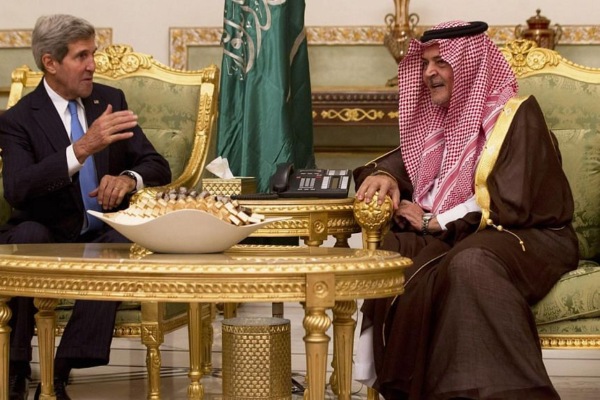 US Secretary of State John Kerry (left) talks with Saudi Foreign Minister Saud al-Faisain Riyadh, Saudi Arabia on Sunday, Nov 3, 2013. MrKerry said on Monday the US relationship with Saudi Arabia should stay on track, as he visited the oi