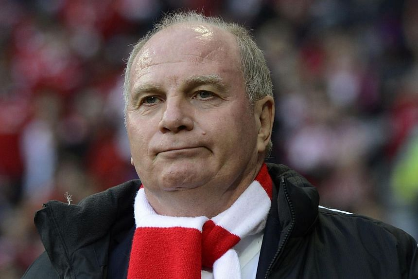 Bayern Munich president Uli Hoeness (above) will face trial from next March on charges that he hid more than a hundred million euros (more than S$170 million) from the tax authorities in a Swiss bank account, a court said on Monday, Nov 4, 2013. -- F