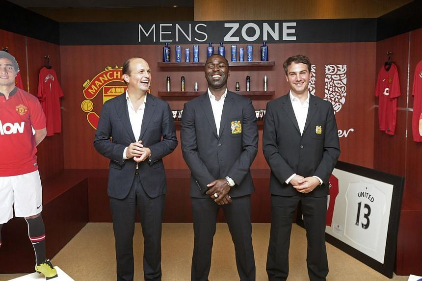 Posing for a picture (from left) are Mr Peter ter Kulve, President of Unilever, SEA and Australasia, Mr Andy Cole, former Manchester United player and Mr Jamie Reigle, MD, Apac, Manchester United. Consumer goods giant Unilever has inked a three-year