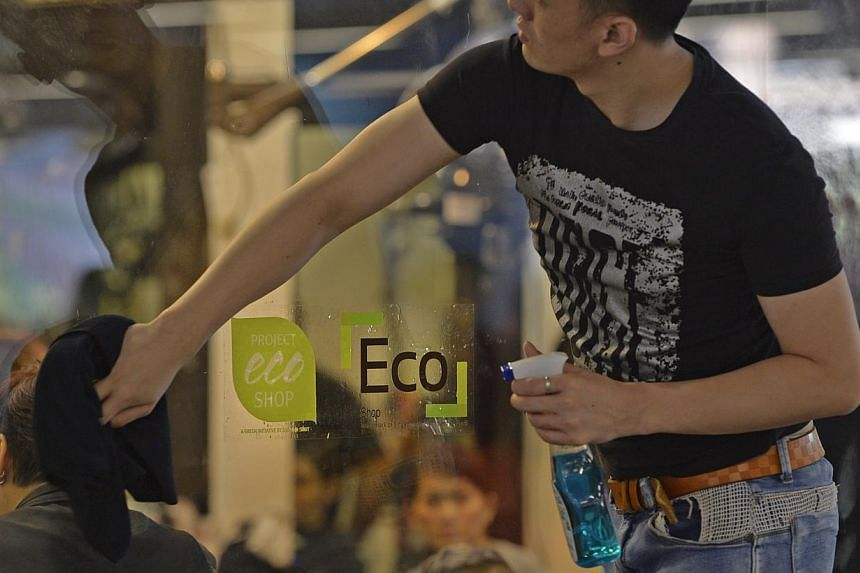 A shop with the Eco-Shop Label at the Woodlands MRT Xchange.-- ST PHOTO: DESMOND FOO