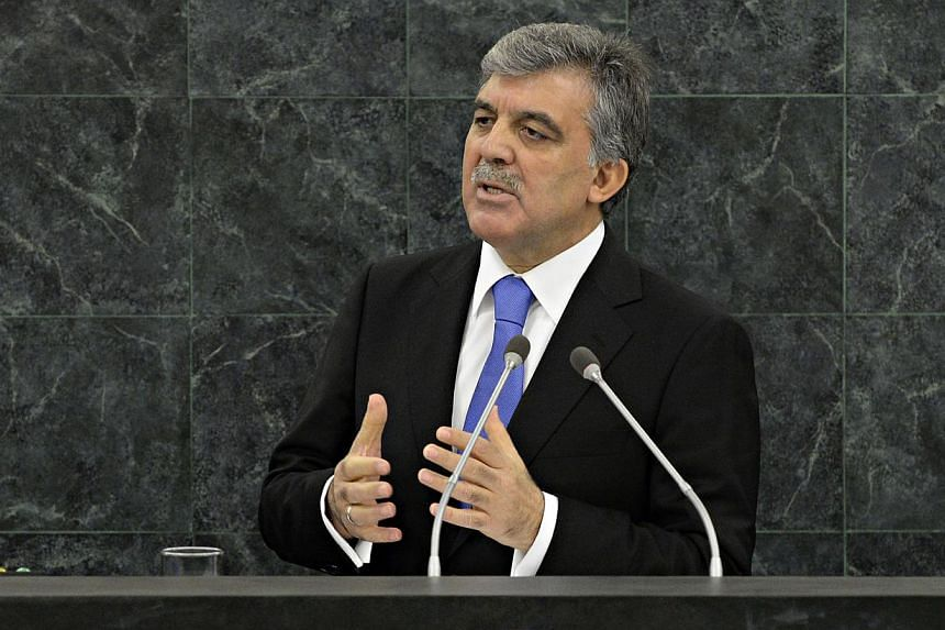 "Turkey's President Abdullah Gul gestures as he speaks during his address to the 68th Session of the United Nations General Assembly on Sept 24, 2013 at UN headquarters. Syria could become a ""Mediterranean Afghanistan"" if the international community d"